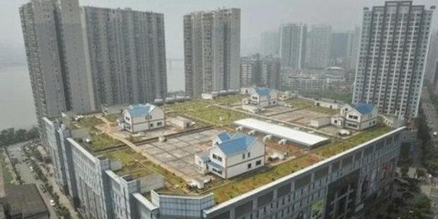 Domy na střechách mrakodrapů: jak žijí lidé
